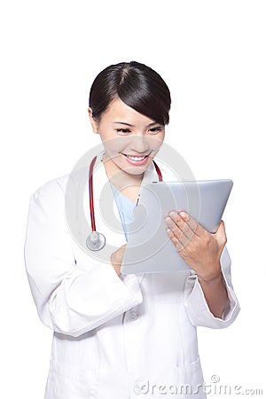 Close up of woman doctor using tablet pc