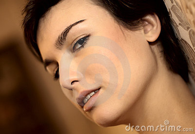 Close-up woman face at brown bokeh background