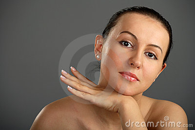 Close-up woman face rests in arm and hand