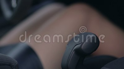 Close up woman hand pulling handbrake lever in car stock footage