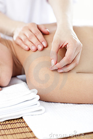 Close-up of a woman having acupuncture treatment