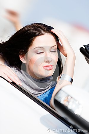 Close up of woman with her eyes shut in the car