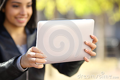 Close up of a woman holding and watching a digital tablet