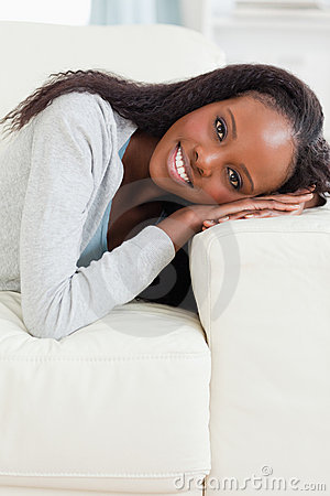 Close up of woman lying on the couch
