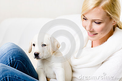 Close up of woman with puppy on her knees
