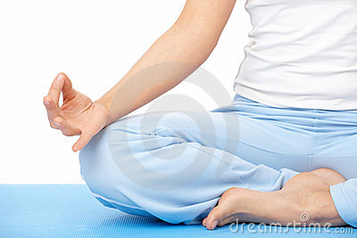 Close-up woman s hand doing yoga exercise on mat
