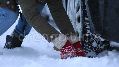 Close up of woman shoveling snow from car stock footage