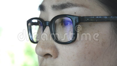 Close up of woman working with computer. Close up of woman's moving eyes, working with computer stock video footage