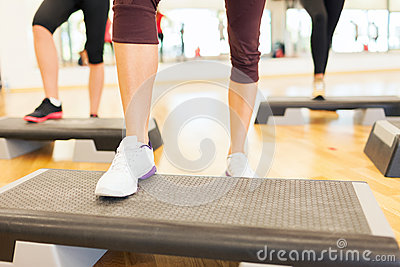 Close up of women legs steping on step platform