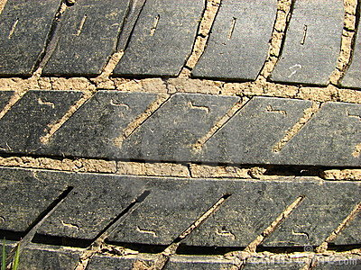 Close-up of worn and muddy tire