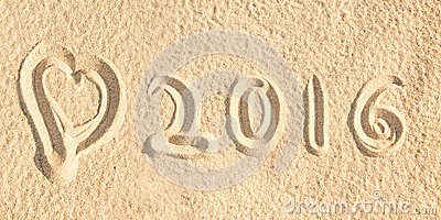 Close up on 2016 written in the sand of a beach Stock Photo