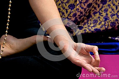 Close up of yogi hand in om position