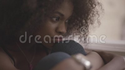 Close up of young beautiful black woman feeling very sad. Gorgeous girl in despair.