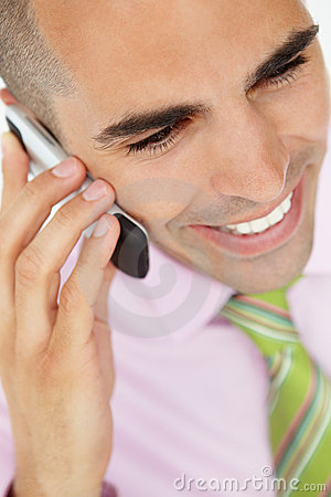 Close up of young businessman using cellphone