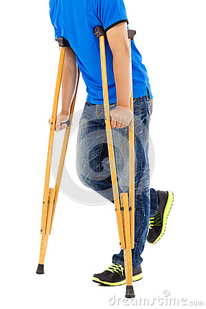 Close up of young man on crutches.