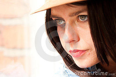 Close up of young stylish woman staring