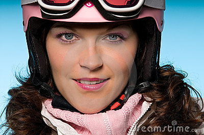 Close-up of young woman wearing pink ski helmet