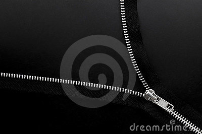 Close up of zipper on black background.