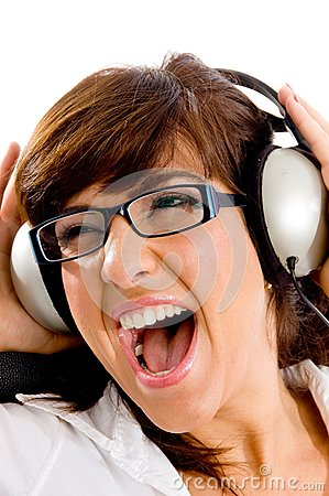 Close view of shouting woman listening music