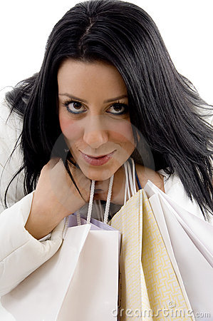 Close view of smiling model with carry bags