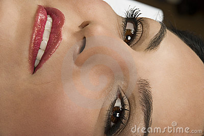 Close of woman face smile and eyes