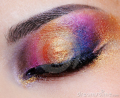 Closed eye with multicoloured eyeshadow