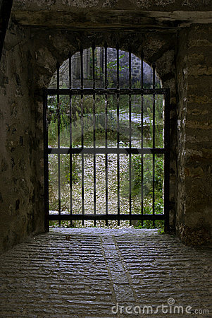 Closed gate at the end of a tunnel