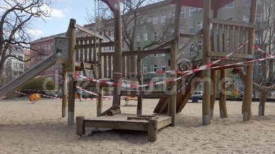Closed playground with barrier tape due to corona pandemic in Berlin, Germany stock video footage