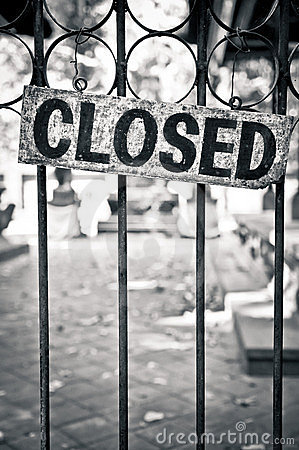 Closed sign on a metal bars