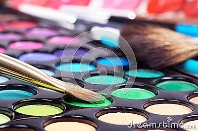 Closed-up professional make-up brush on green make