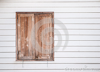 Closed vintage wooden window on white wall