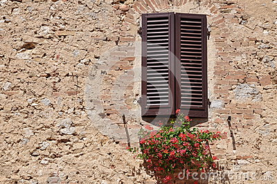 Closed window on a stone wall