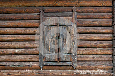 Closed window on wooden house