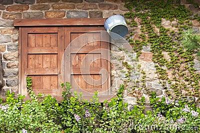 Closed wood window on aged brick wall