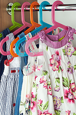 Closet with baby dresses