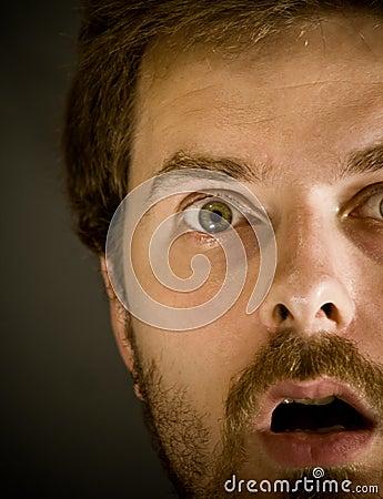 Closeup on amazed scared man