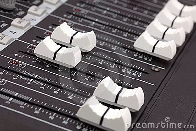 Closeup of audio mixing console.