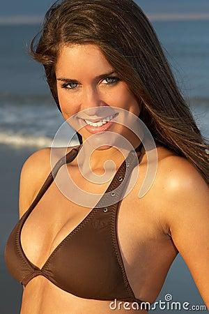 Closeup of Beautiful Young Brunette Woman in Brown Bikini