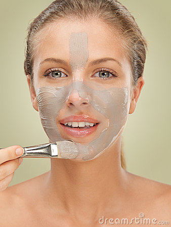 Closeup beauty portrait woman applying facial mask