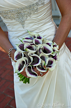 Closeup of a bride holding bouquet