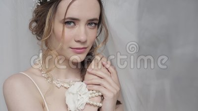 Closeup brunette bride with fashion wedding hairstyle and makeup. Wedding day of bride. Closeup beauty woman. Fashion brunette model indoors. Beauty portrait stock video