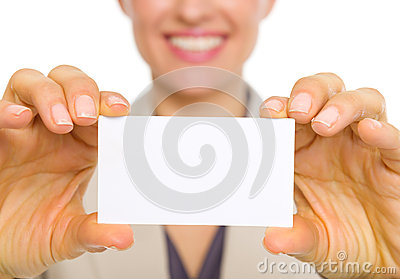 Closeup on business card in hand of business woman