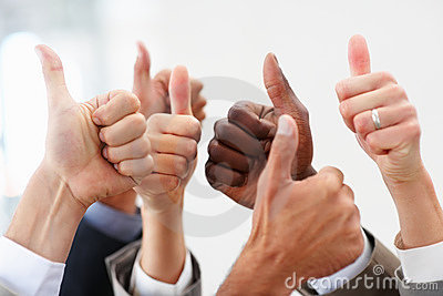 Closeup business colleagues showing thumbs up