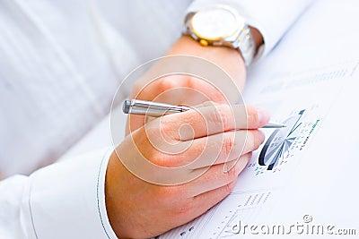 Closeup of a business man analysing graph