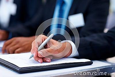 Closeup of a business man filling form