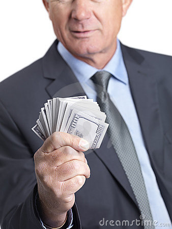Closeup of a business man holding American dollars