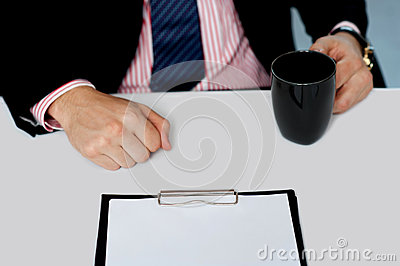 Closeup of businessman holding empty cup