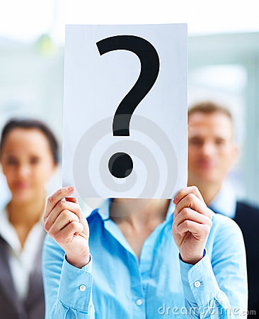 Closeup of businesspeople holding question mark
