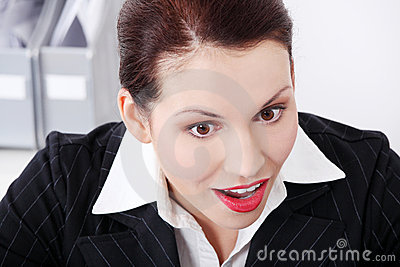 Closeup on businesswoman`s surprised face.