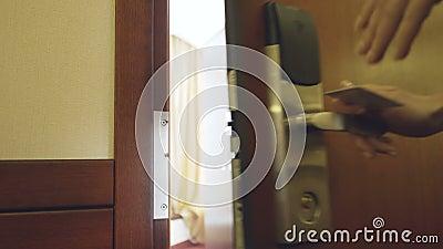 Closeup of businesswoman in suit open hotel room door using contactless key card and entering the room. Travel, business. Close-up of businesswoman in suit open stock footage